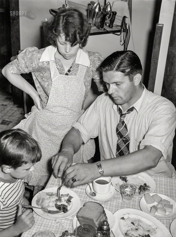 July 1938. Aliquippa, Pennsylvania.The Clifford Shorts family at dinner. Mr. Shorts is a rolle...jpg