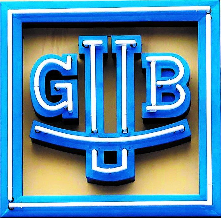 Markus-Dressler_Reinhard-Reichel_and-Frank-Kittel-on-the-Balcony-decorated-with-GUB-Logo.jpg